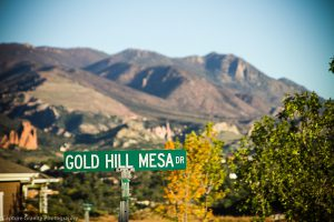 gold hill mesa street sign with mountains in background