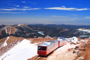 Red COG Railway train on the side of Pikes Peak