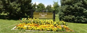 Bear Creek Park Sign with Flowers Photo